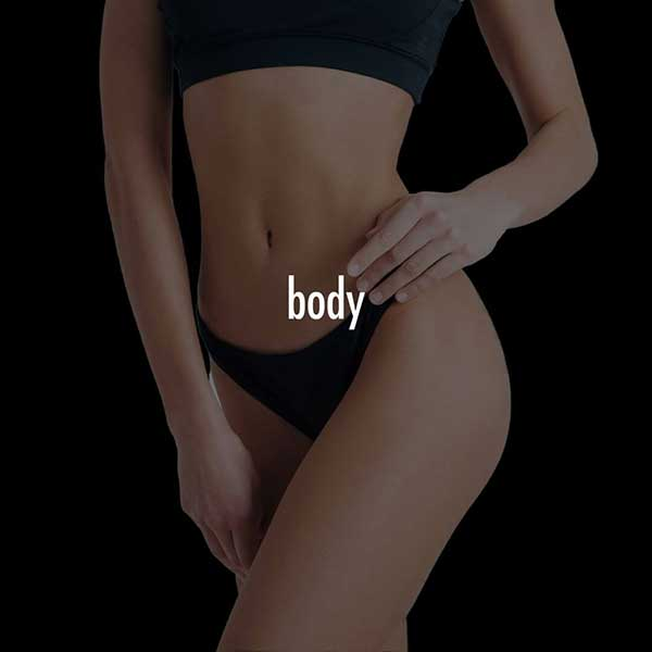 Woman posing showing her results from our cosmetic surgeon at Advanced BodySculpting of New England.